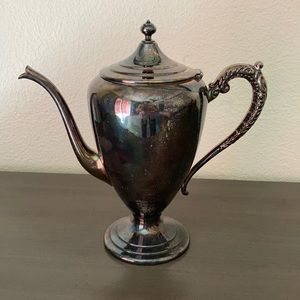 Antique copper on silver coffee pot